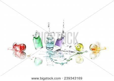 High Speed Photograpy Of Bottles With Colorful Liquid