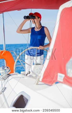 Girl Captain On Board Of Sailing Yacht On Summer Cruise. Travel Adventure, Yachting With Child On Fa