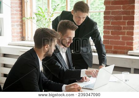 Male Ceo Explaining Colleagues Strategies Of Successful Online Business, Discussing Together Annual