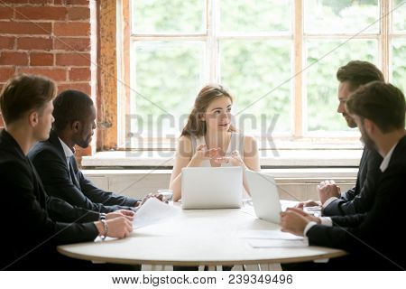 Female Ceo Explaining Company Strategy To Male Colleagues. Work Team Analyzing Financial Rates On Ma