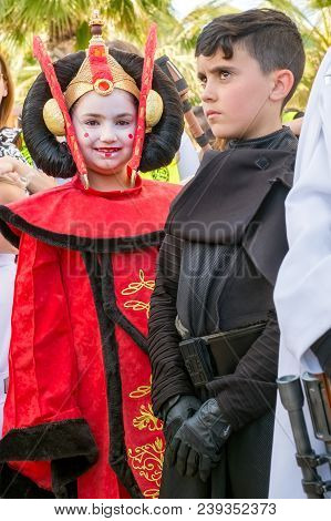 Malaga, Spain - May 05, 2018. Member Of The 501st Legion Spanish Garrison Child Dressed As  Padme Am