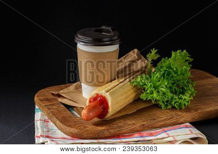 French Hot Dog And Coffee On Black Background