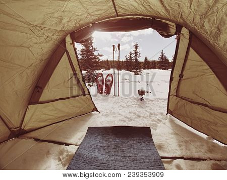 Camping In Winter Forest, Cooking In Front Of Tent In Snow. Making A Bonfire Campfire And Cooking Fo