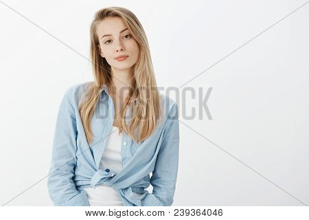 Portrait Of Unimpressed Attractive Stylish Woman With Blond Hair, Smirking And Looking Indifferent A