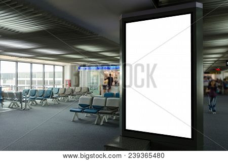 Mock Up Of Vertical Blank Advertising Billboard Or Light Box Showcase With People Waiting At Airport