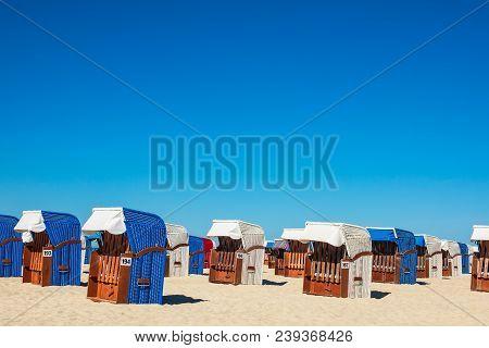 Beach Chairs On The Baltic Sea Coast In Warnemuende, Germany.