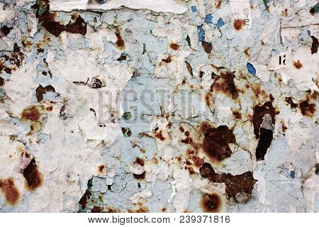 Old, Torn Bulletin Board. Street Empty Public Billboard, Dirty Wall With Rust. Bright Colorful Backg