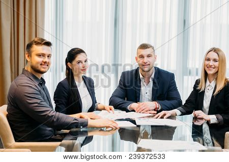 Happy Successful Team Of Confident Business Men And Women Sitting In A Board Room. Corporate People