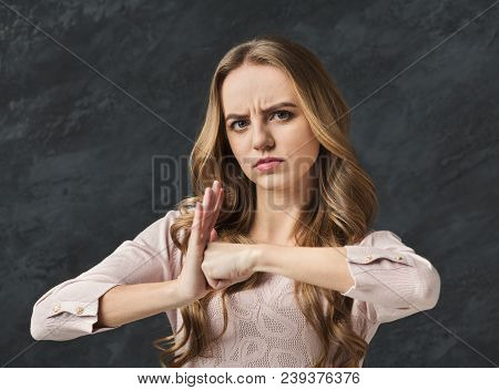 Tough Girl. Angry Woman Punching Her Palm With Fist. Upset Girl Ready To Fight And Quarrel, Looking