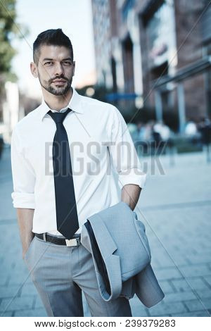 Portrait of confident businessman outdoors on street.