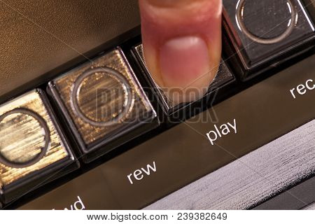 Finger Pressing Retro Play Button On Vintage Music Player - Macro Closeup