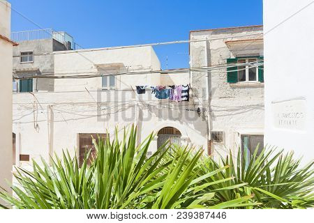 Vieste, Apulia, Italy - Laundry Drying On A Balcony In The Streets Of Vieste
