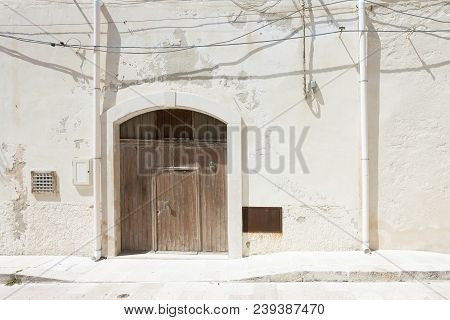 Vieste, Apulia, Italy - A Folding Gate, Two Rainwater Pipes And Some Cables