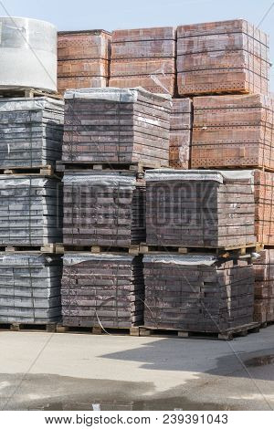 New Bricks On Pallets. Pallets With Bricks In The Building Store. Racks With Brick. Masonry, Stonewo