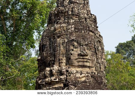 Carved Tower Bas-relief Of Angkor Wat Complex Temple, Siem Reap, Cambodia. Ancient Khmer Architectur