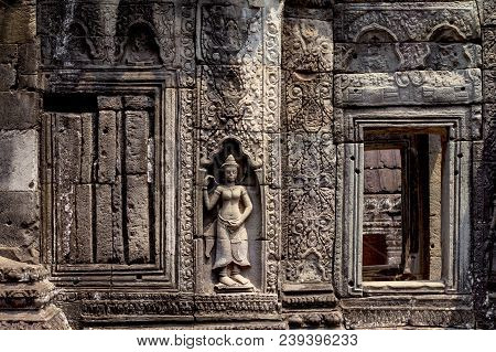 Carved Wall Bas-relief Of Angkor Wat Complex Temple, Siem Reap, Cambodia. Ancient Khmer Architecture