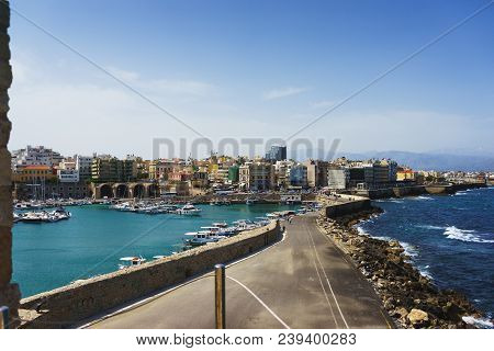 Travel In Summer To Heraklion. Magic View Of The City From The Wall Of The Fortress Kules. The Pier