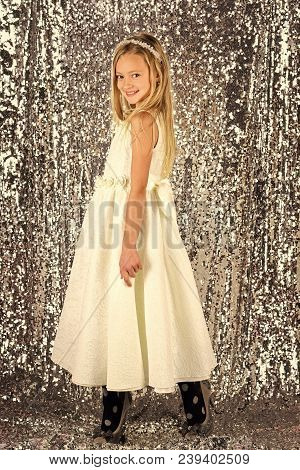 Fashion model on silver background, beauty. Little girl in fashionable dress, prom. Fashion and beauty, little princess. Look, hairdresser, makeup. Child girl in stylish glamour dress, elegance. poster