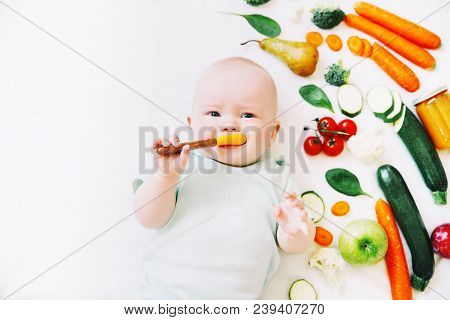Healthy Child Nutrition, Food Background, Top View. Baby 8 Months Old Surrounded With Different Fres