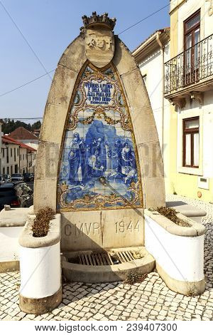 Vila De Rei, Portugal - October 10, 2017: View Of The Public Water Fountain With An Exodus, Xvii, 6