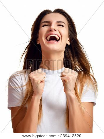 Brunette Woman Doing A Winner Gesture Happy Laughing Excited Looking Up With Closed Eyes Isolated On