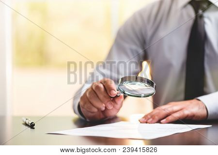 Businessman Is Reading Contract Details Before Signing