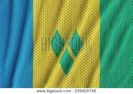 Saint Vincent and the Grenadines flag printed on a polyester nylon sportswear mesh fabric with some folds poster