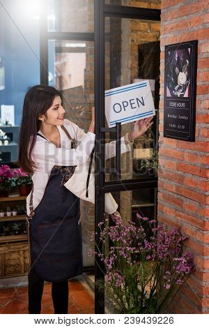 Woman Owner Smiling Florist Stands Holding An Open Sign Small Business. Botany Bouquet Blooming