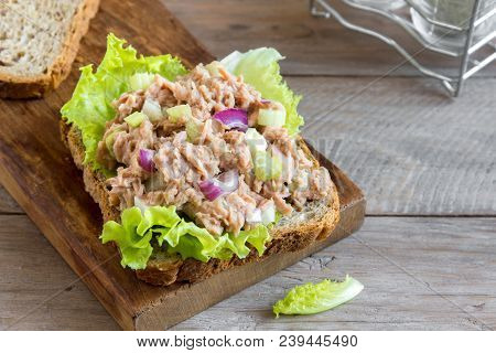 Tuna Salad Sandwich Over Wooden Background, Close Up. Homemade Sandwich With Tuna And Vegetables For