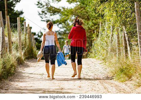 Women walking with nordic walking sticks