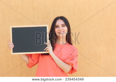 Cheerful Promoter Woman Holding Blackboard Advertising Sign