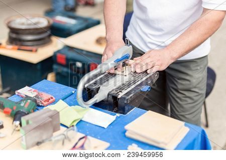Man Working With Jig Saw. Fretsaw Tool Stationary Fixed On Table. Person Making Wooden Figures With