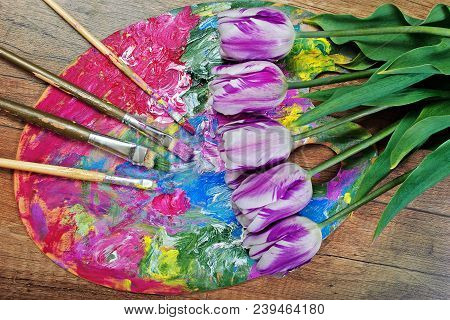 A Palette Of Artists And Brushes. Purple Tulips On A Palette.