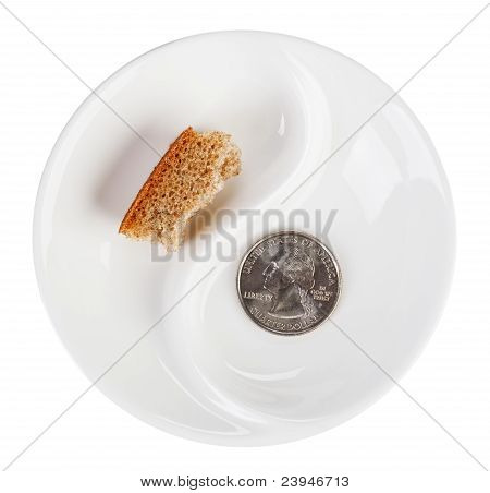 Poverty Concept Photo With Quarter Dollar Coin And Bread Crust On White Plate