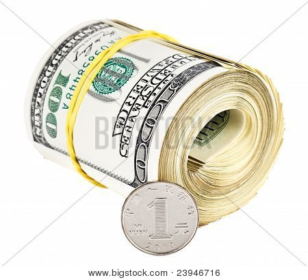 One Chinese Yuan Coin Versus Bundle Of Rolled Up Us Dollars, Currency Concept Photo