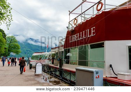 France, Annecy - May 01, 2018: Boats Moored Along Lake Annecy Used To Transport Tourists.