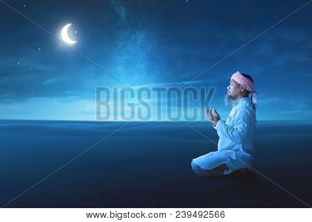Elderly Asian Muslim Man Raise Hand And Praying At Night