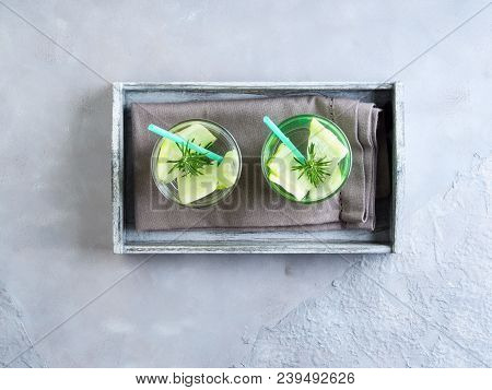 Infused Water With Cucumber And Rosemary Herb In Glasses. Healthy Lifestyle