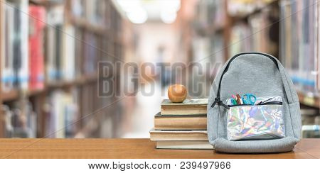 Back To School Concept With School Books, Textbooks, Backpack And Stationery Supplies On Classroom D