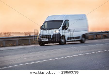 Truck Is Moving Along The Highway At Sunrise