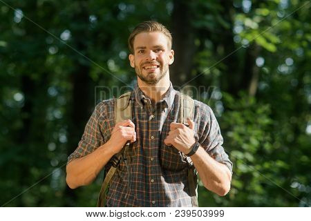 Handsome Bearded Male Backpacker With Backpack On His Shoulders. Attractive Tourist With Backpack. T