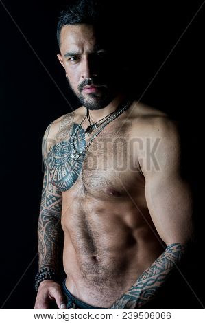 Fit Model With Tattoo Art On Skin. Bearded Man With Tattooed Chest. Macho With Sexy Bare Torso. Spor