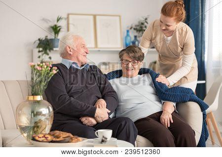 Senior Couple And Tender Caregiver
