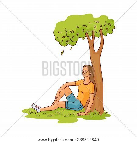 Young Slim Woman Sitting Under Green Tree On Summer Grass Smiling Having Rest, Relaxing After Work O