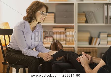 Therapist Listening To A Man