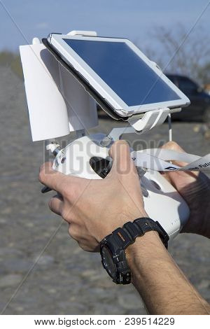 Man Hands Holding Remote Controller Using Tablet For Drones Flying. Close-up On Men Hands Of Drone O