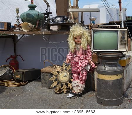Vintage Doll, Tv, Clock And Other Old Stuff At Flea Market.