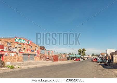 Estcourt, South Africa - March 21, 2018: A Street Scene With Businesses And Vehicles In Estcourt In