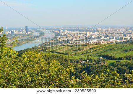 Austria. View Of Vienna And The Danube River From Mount Leopoldsberg In A Sunny Summer Evening