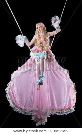 Pretty girl in fary-tale doll costume fly in dark